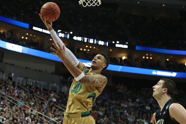 Mar 21, 2015; Pittsburgh, PA, USA; Notre Dame Fighting Irish forward Zach Auguste (30) shoots the ball past Butler Bulldogs forward Andrew Chrabascz (45) during the second half in the third round  ...