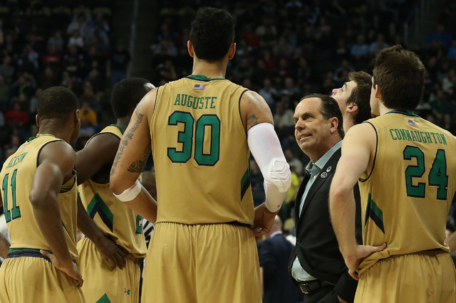Mar 21, 2015; Pittsburgh, PA, USA; Notre Dame Fighting Irish head coach Mike Brey (C) huddles with his team during a stoppage in play against the Butler Bulldogs in the third round of the 2015 NCA ...