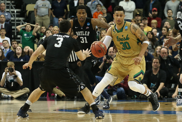 Mar 21, 2015; Pittsburgh, PA, USA; Notre Dame Fighting Irish forward Zach Auguste (30) is call for a double dribble during the final seconds of the second half against the Butler Bulldogs in the t ...