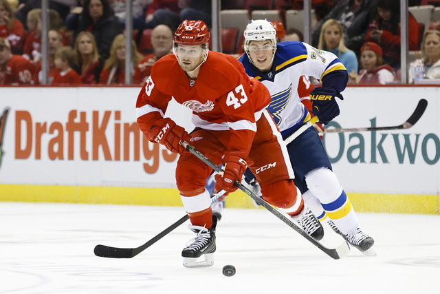 Mar 22, 2015; Detroit, MI, USA; Detroit Red Wings center Darren Helm (43) skates with the puck chased by St. Louis Blues right wing T.J. Oshie (74) in the first period at Joe Louis Arena. (Rick Os ...