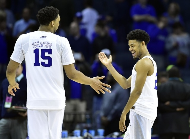 Mar 22, 2015; Charlotte, NC, USA; Duke Blue Devils guard Quinn Cook (2) celebrates with center Jahlil Okafor (15) after the game against the San Diego State Aztecs in the third round of the 2015 N ...