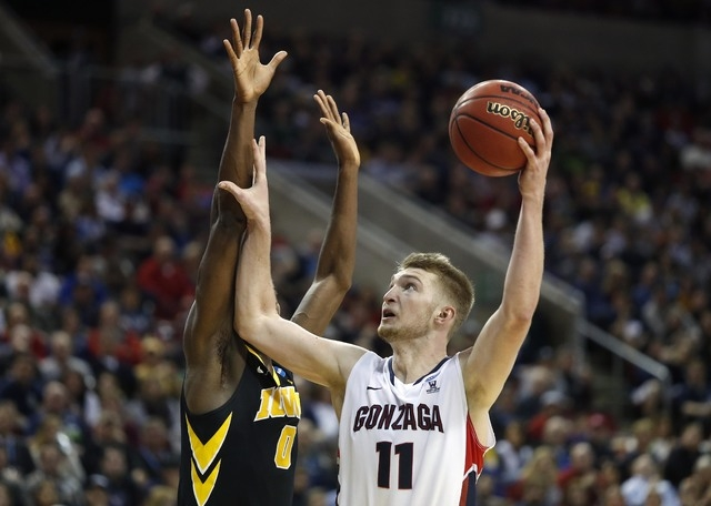March 22, 2015; Seattle, WA, USA; Gonzaga Bulldogs forward Domantas Sabonis (11) shoots against Iowa Hawkeyes center Gabriel Olaseni (0) during the second half in the third round of the 2015 NCAA  ...
