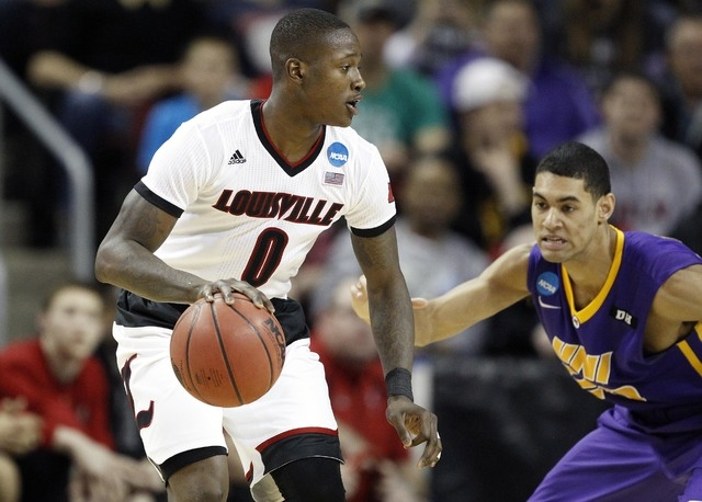 March 22, 2015; Seattle, WA, USA; Louisville Cardinals guard Terry Rozier (0) controls the ball against Northern Iowa Panthers during the second half in the third round of the 2015 NCAA Tournament ...