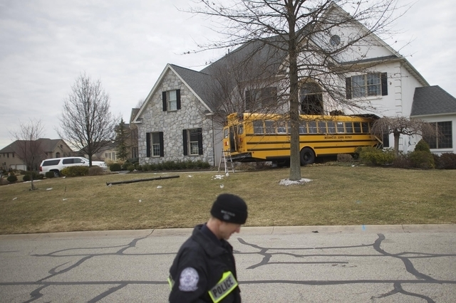 A school bus crashed into a house at the Windermere Development in Blue Bell, Pennsylvania, March 24 2015. The school bus carrying nine elementary school students careened off the road and crashed ...