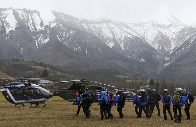 French Police and Gendarmerie Alpine rescue units gather on a field as they prepare to reach the crash site of an Airbus A320, near Seyne-les-Alpes, in the French Alps, March 24, 2015. An Airbus p ...