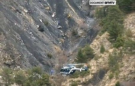 A rescue helicopter from the French Gendarmerie hovers in front of the crash site of an Airbus A320, near Seyne-les-Alpes, March 24, 2015 in this still image taken from TV.   REUTERS/BFM via Reute ...