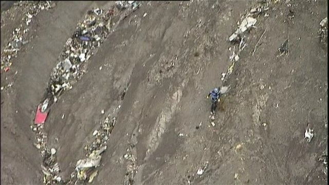 A French gendarme makes his way around debris from an Airbus A320 in the mountains, near Seyne-les-Alpes, March 24, 2015 in this still image taken from TV.  The Airbus operated by Lufthansa's Germ ...
