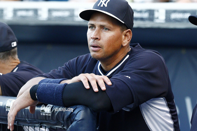 Mar 24, 2015; Tampa, FL, USA; New York Yankees third baseman Alex Rodriguez (13) watches from the dugout during the first inning of a spring training baseball game against the Detroit Tigers at Ge ...