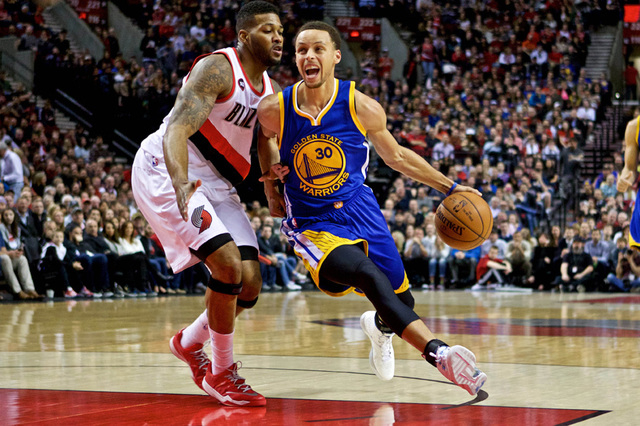 Mar 24, 2015; Portland, OR, USA; Golden State Warriors guard Stephen Curry (30) drives past Portland Trail Blazers forward Alonzo Gee (33) during the first quarter at the Moda Center. Mandatory Cr ...
