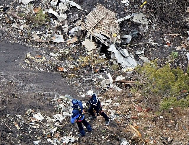 A photo released March 25, 2015, by the French Interior Ministry shows search operations at the crash site of an Airbus A320, near Seyne-les-Alpes. French investigators will sift through wreckage  ...