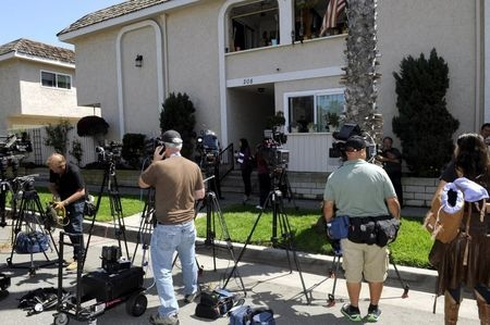 Media are seen outside the apartment where kidnap victim Denise Huskins was staying in Huntington Beach, California, Wednesday, March 25, 2015. (Reuters/Bob Riha Jr.)