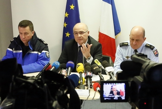 French prosecutor of Marseille, Brice Robin, center, flanked by Gendarmerie General David Galtier, right, attends a news conference at the Marignane Airport, near Marseille, March 26, 2015. The co ...