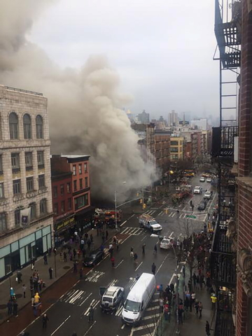 Smoke pours from a building after it collapsed in New York City's East Village as seen in this picture taken by Scott Westerfeld March 26, 2015.  Rescuers from the Fire Department of New York (FDN ...