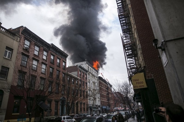 Flames rise from a building fire in the East Village neighborhood of New York City on March 26, 2015. (REUTERS/Ben Hider)