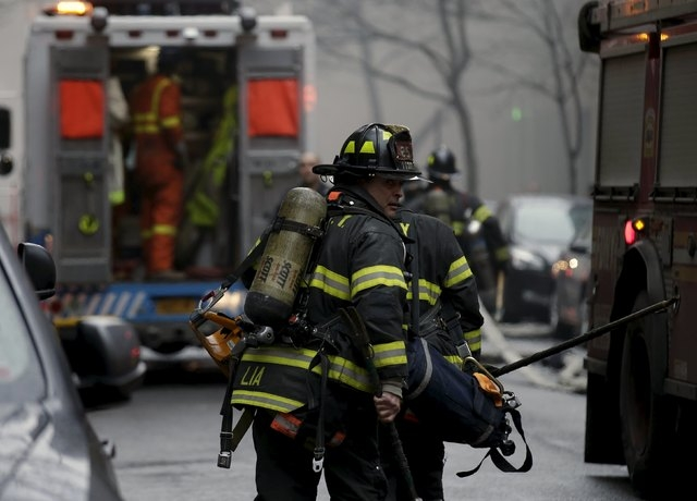 New York City Fire Department firefighters respond to a residential apartment building fire in New York City's East Village neighborhood March 26, 2015. The residential apartment building collapse ...