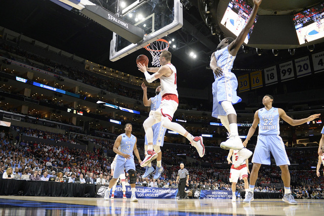 Mar 26, 2015; Los Angeles, CA, USA; Wisconsin Badgers forward Sam Dekker (15) moves in to score a basket against North Carolina Tar Heels during the first half in the semifinals of the west region ...