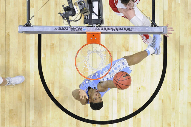 Mar 26, 2015; Los Angeles, CA, USA; North Carolina Tar Heels forward Isaiah Hicks (22) scores a basket against Wisconsin Badgers during the second half in the semifinals of the west regional of th ...