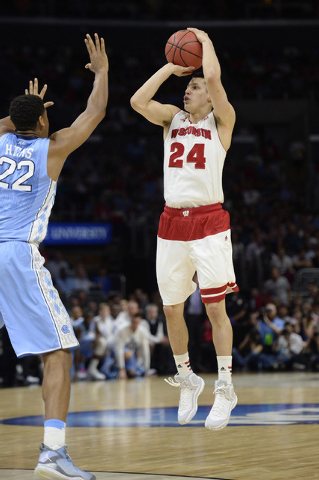 Mar 26, 2015; Los Angeles, CA, USA; Wisconsin Badgers guard Bronson Koenig (24) shoots against North Carolina Tar Heels forward Isaiah Hicks (22) during the second half in the semifinals of the we ...