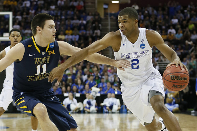 Mar 26, 2015; Cleveland, OH, USA; Kentucky Wildcats guard Aaron Harrison (2) dribbles against West Virginia Mountaineers forward Nathan Adrian (11) during the first half in the semifinals of the m ...