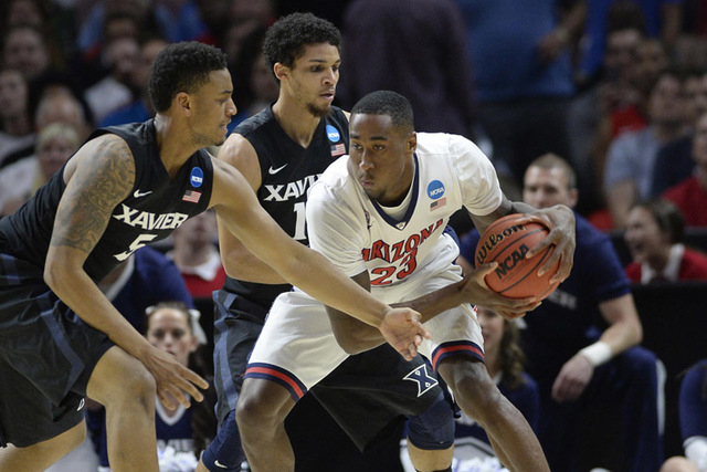 Mar 26, 2015; Los Angeles, CA, USA; Arizona Wildcats forward Rondae Hollis-Jefferson (23) moves the ball against Xavier Musketeers forward Trevon Bluiett (5) and guard Dee Davis (11)  during the f ...