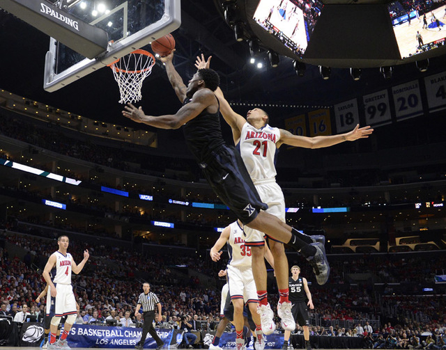 Mar 26, 2015; Los Angeles, CA, USA; Xavier Musketeers forward Jalen Reynolds (1) moves to the basket against Arizona Wildcats forward Brandon Ashley (21) during the first half in the semifinals of ...