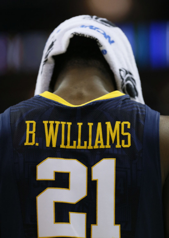 Mar 26, 2015; Cleveland, OH, USA; West Virginia Mountaineers forward BillyDee Williams (21) reacts during the second half against the Kentucky Wildcats in the semifinals of the midwest regional of ...