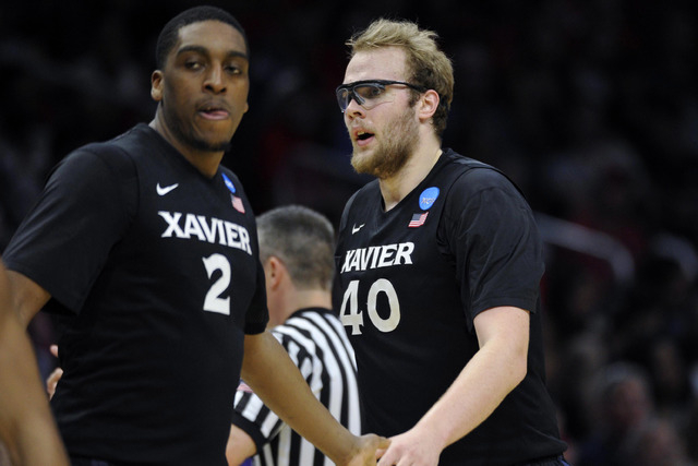 Mar 26, 2015; Los Angeles, CA, USA; Xavier Musketeers center Matt Stainbrook (40) reacts with forward James Farr (2) after a scoring play against Arizona Wildcats during the second half in the sem ...