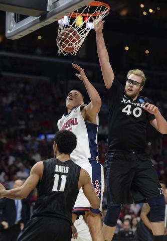 Mar 26, 2015; Los Angeles, CA, USA; Xavier Musketeers center Matt Stainbrook (40) scores a basket against Arizona Wildcats center Kaleb Tarczewski (35) during the second half in the semifinals of  ...