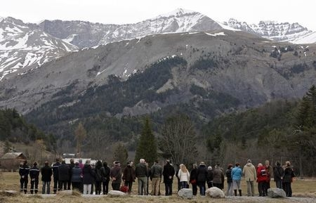 People pay their respects at the memorial for the victims of the air disaster in the village of Le Vernet, near the crash site of the Germanwings Airbus A320 in French Alps, March 28, 2015. (Reute ...
