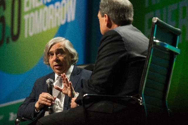 Department of Energy Secretary Ernest Moniz, left, talks with Federal Energy Regulatory Commission Chairman Jon Wellinghoff during a keynote discussion at the National Clean Energy Summit at Manda ...