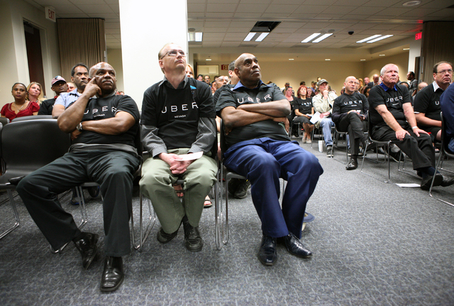 Uber supporters wear matching shirts as they attend a legislative hearing at Grant Sawyer Building Monday, March 30, 2015, in Las Vegas. Southern Nevada taxi drivers and Uber supporters were among ...