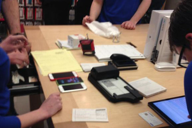 Due to server problems on March 11, 2015, customers at this Apple Store in Birmingham, UK had to pay with credit card imprinters. (Nathan Ziabek/Fresco News)