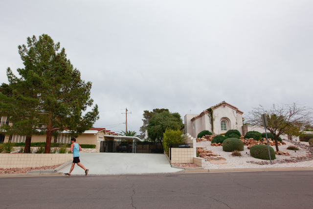 A man jogs along Blackridge Road in the 89015 ZIP code of Henderson, Nev. on Wednesday, March 11, 2015. Homes in 89015 went up more than 28 percent over the past year according to Applied Analysis ...