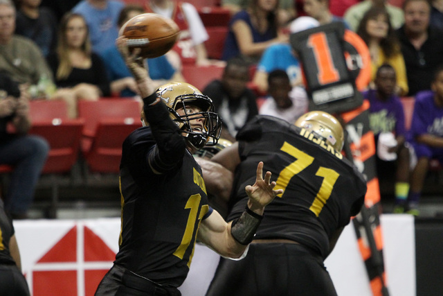Las Vegas Outlaws quarterback J.J. Raterink throws against the San Jose SaberCats during the Outlaws inaugural Arena Football League game Monday, March 30, 2015, at the Thomas & Mack Center. (Sam  ...