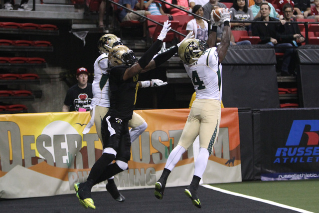 San Jose SaberCats defensive back Virgil Gray intercepts a pass intended for Las Vegas Outlaws wide receiver Clinton Solomon during the Outlaws inaugural Arena Football League game Monday, March 3 ...