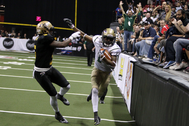 San Jose SaberCats wide receiver Reggie Gray pushes away from Las Vegas Outlaws defensive back Dee Webb during the Outlaws inaugural Arena Football League game Monday, March 30, 2015, at the Thoma ...