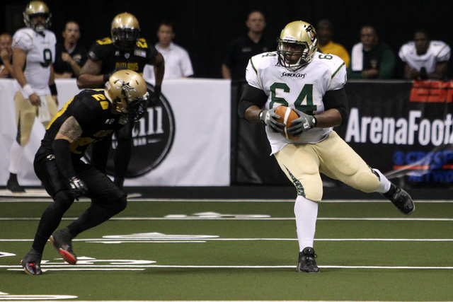 Las Vegas Outlaws linebacker Tanner Varner zeros in on San Jose SaberCats offensive lineman Rich Ranglin during the Outlaws inaugural Arena Football League game Monday, March 30, 2015, at the Thom ...