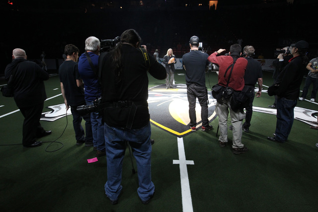 Las Vegas Outlaws owner Vince Neil sings the national anthem before the Outlaws inaugural Arena Football League game against the San Jose SaberCats Monday, March 30, 2015, at the Thomas & Mack Cen ...