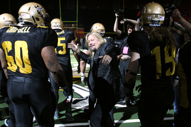 Las Vegas Outlaws owner Vince Neil greets his players before the Outlaws inaugural Arena Football League game against the San Jose SaberCats Monday, March 30, 2015, at the Thomas & Mack Center. (S ...