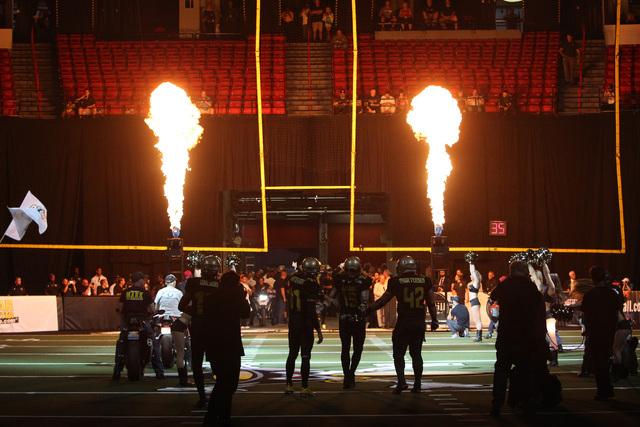 Las Vegas Outlaws make their entrance for their inaugural Arena Football League game against the San Jose SaberCats Monday, March 30, 2015, at the Thomas & Mack Center. (Sam Morris/Las Vegas Revie ...