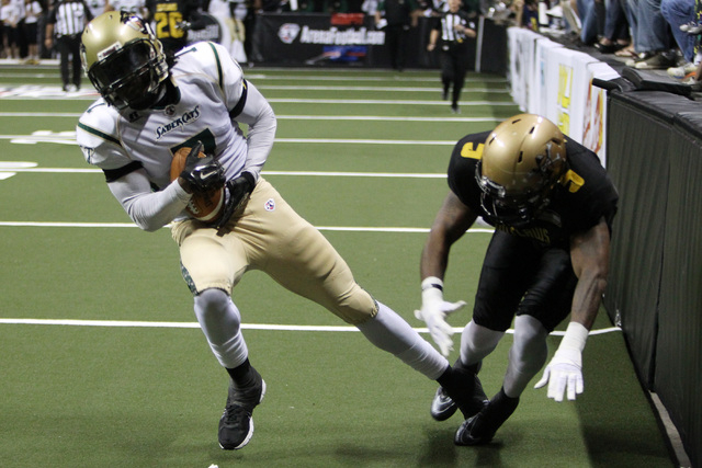 San Jose SaberCats wide receiver Reggie Gray beats Las Vegas Outlaws defensive back Dee Webb during the Outlaws inaugural Arena Football League game Monday, March 30, 2015, at the Thomas & Mack Ce ...