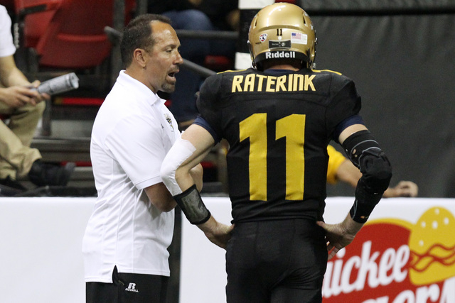 Las Vegas Outlaws head coach Aaron Garcia talks to quarterback J.J. Raterink during the Outlaws inaugural Arena Football League game against the San Jose SaberCats Monday, March 30, 2015, at the T ...