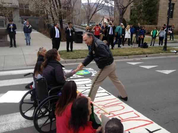 Carson City Sheriff Ken Furlong greets protestors. (Sean Whaley/Las Vegas Review-Journal)