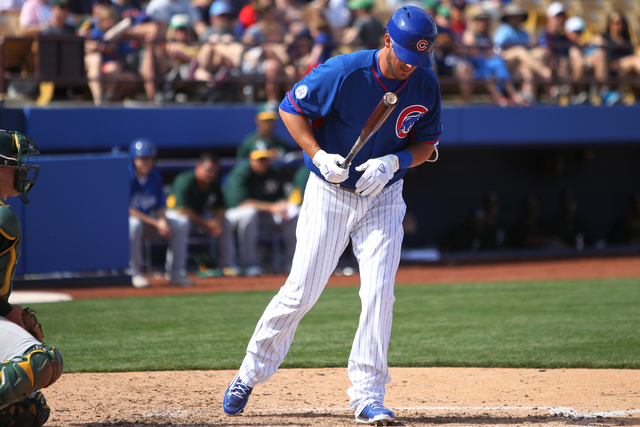 Kris Bryant (76) is walked to first base in the eight inning after hitting two home runs earlier in the game against the Oakland Athletics in their Major League Baseball game at Cashman Field in L ...