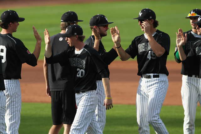 UNLV baseball players exchange high fives after a 7-1 defeat of Grand Canyon University Tuesday, March 17, 2015 at Earl E. Wilson Stadium. (Sam Morris/Las Vegas Review-Journal)