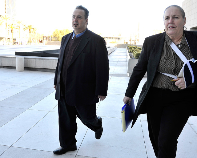 Leon Benzer, left, the alleged mastermind of the scheme to take over homeowner associations, arrives at the Lloyd George U.S. Courthouse on Friday, Jan. 23, 2015. Benzer pleaded guilty before U.S. ...