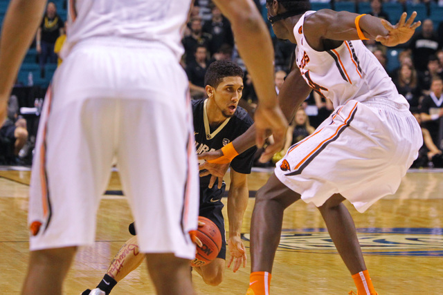 Colorado guard Askia Booker looks for a way through the Oregon State defense during the first half of their Pac-12 Conference tournament game Wednesday, March 11, 2015, at the MGM Grand Garden Are ...