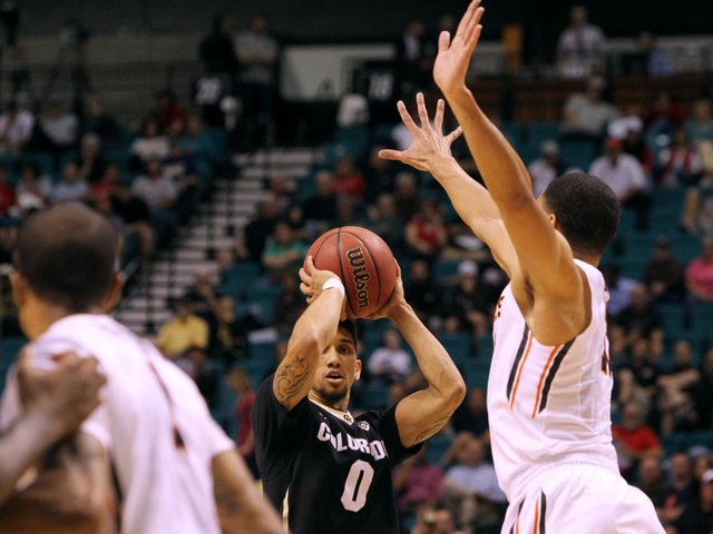 Colorado guard Askia Booker takes a shot from deep against Oregon State during the first half of their Pac-12 Conference tournament game Wednesday, March 11, 2015, at the MGM Grand Garden Arena. ( ...