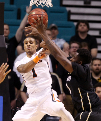 Oregon State guard Gary Payton II has his pass deflected by Colorado forward Wesley Gordon during the first half of their Pac-12 Conference tournament game Wednesday, March 11, 2015, at the MGM Gr ...