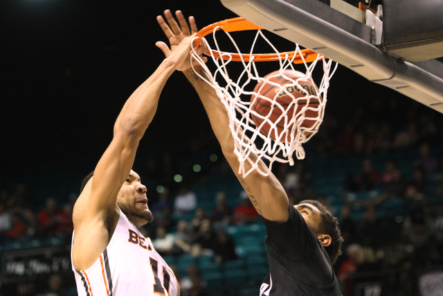 Oregon State guard Malcolm Duvivier dunks on Colorado forward Josh Scott during the second half of their Pac-12 Conference tournament game Wednesday, March 11, 2015, at the MGM Grand Garden Arena. ...